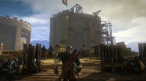 Geralt charges into battle in The Witcher 2 prologue.